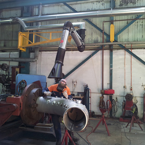 200Ø articulated extraction arm mounted to 4m extension boom. Air volume of 2000m³/hr. Heavy fabrication shop in NZ.