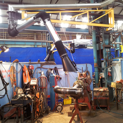 Pipe fabrication bay using 200Ø 3m articulated extraction arm with 2000m³/hr mounted on 4m extension boom and part of a centralised system of ten units. Tenix NZ.