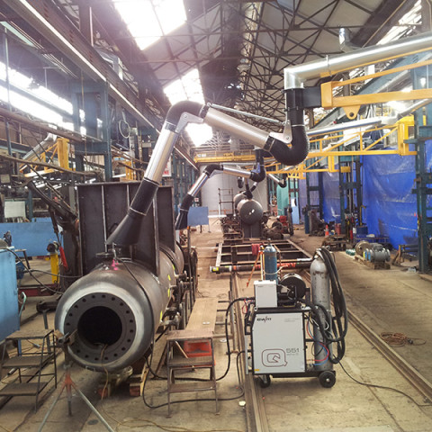 Large heavy fabrication shop fitted with centralised system with 4m extension booms with 3m extraction arms. Tenix NZ.