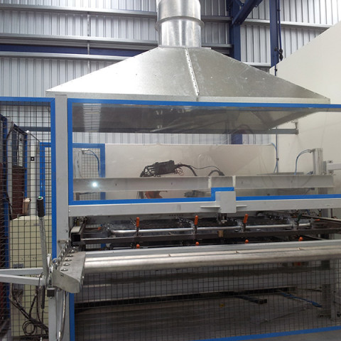 Robot welding machine fitted with extraction hood ducted to outside atmosphere.