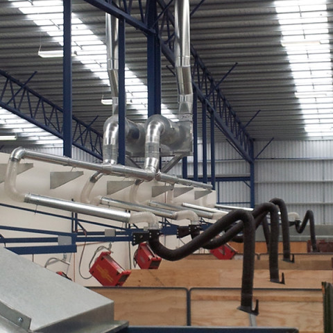 Armoflex 3m articulated extraction arms installed to 2m extension booms and centralised extraction systems with fan and attenuators.