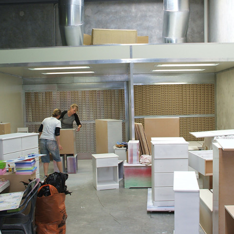 Purpose built open-faced spray booths. Furniture painting.