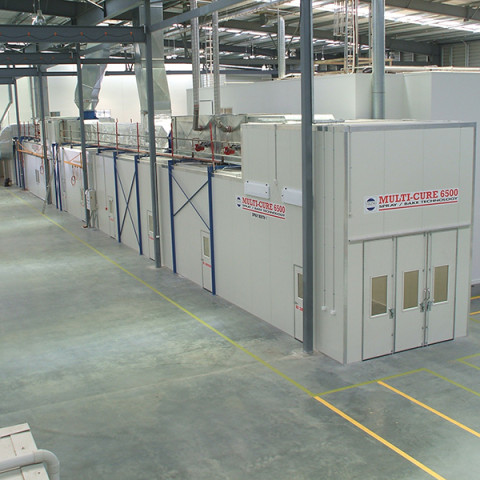 5m x 5m x 75m long positive pressure heated spray and bake booth to 80°C for superyacht spar manufacturers. Southern Spars.