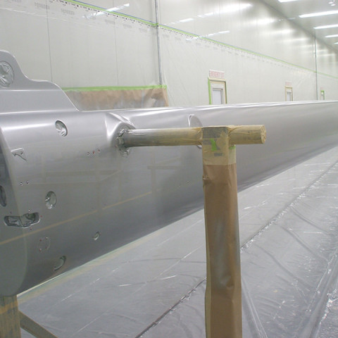65m spars being spray painted.
