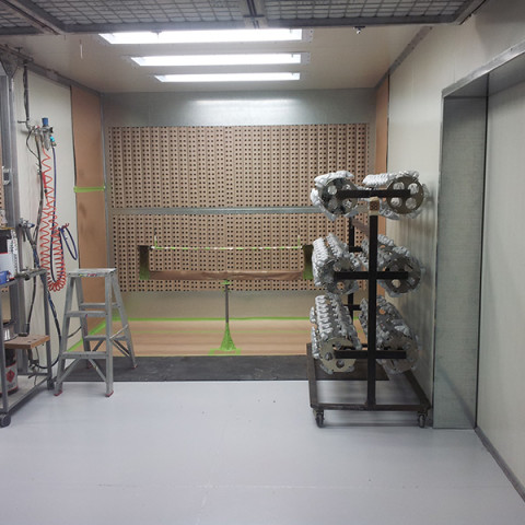 Purpose built production booths. Dual operators, heated spray booths. Internal access to curing oven with 80°C for vacuum metallization process. Shoplands, Auckland.